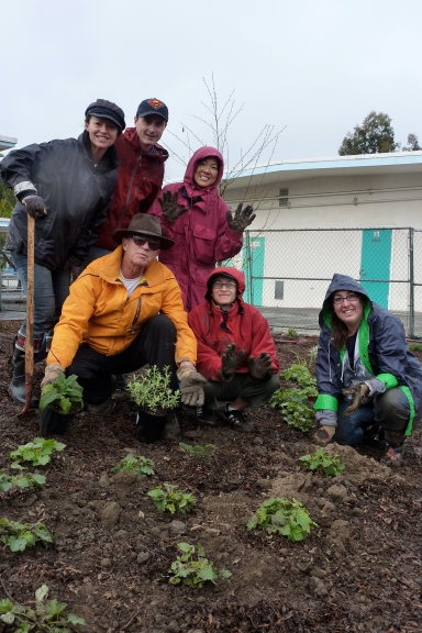 Lu Plauzoles helps with planting at Walgrove School